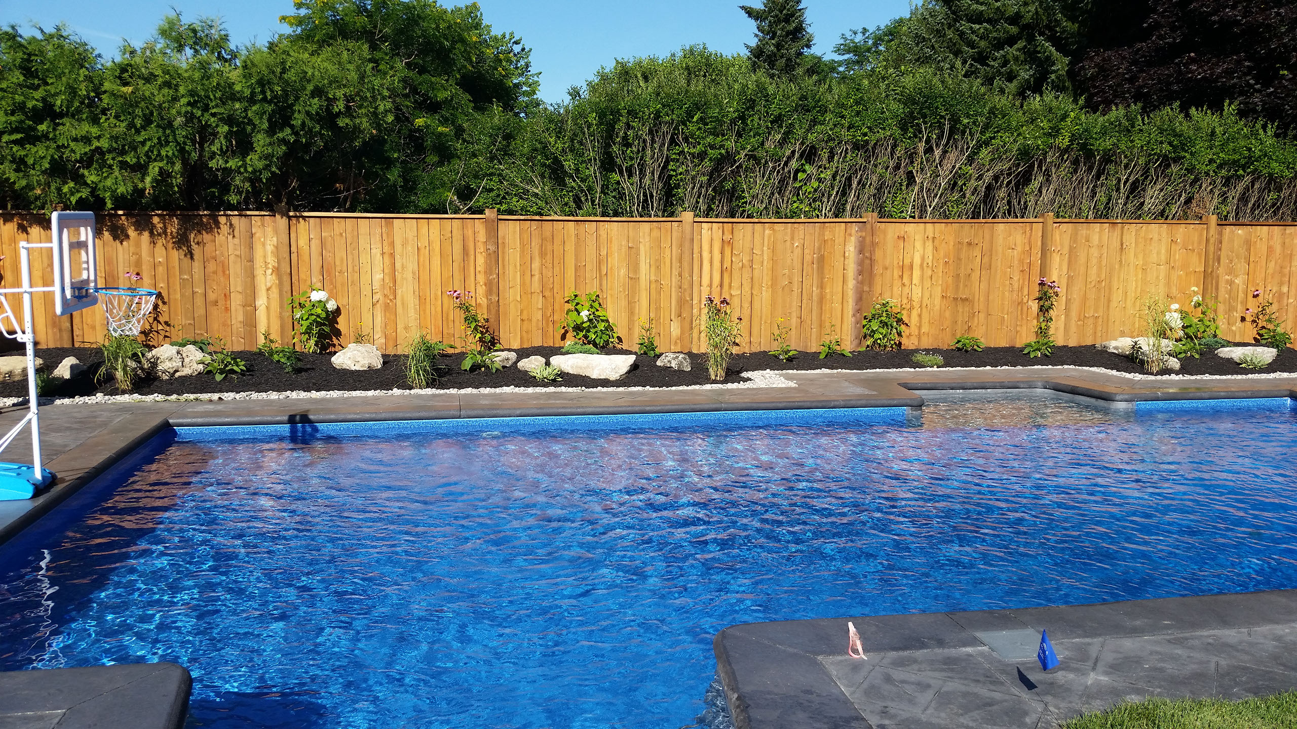 Flandscape landscaping pool installation snow plowing for Pool design london ontario